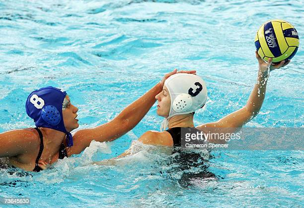 Luiza Carvalho of Brazil defends against Sandra Lize of Canada in the Women's Preliminary Round Group B Water Polo match between Canada and Brazil at...