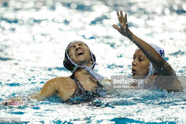 Luiza Carvalho of Brazil is challenged against Priscila Orozco of Mexico in the Women's Water Polo during the Pan American Games Guadalajara 2011 at...