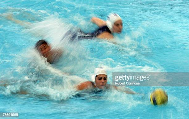 Luiza Carvalho of Spain chases the ball during the Women's Final Round Water Polo match between Spain and Brazil at the Melbourne Sports Aquatic...