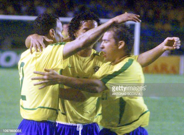 Luizao hugs teammates Ronaldinho Gaucho and Cafu of the brazilian soccer team after scoring a goal against Yugoslavia 27 March 2002 during a friendly...