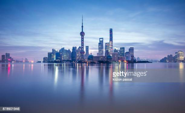 Lujiazui financial district in Shanghai at dusk , China , Asia