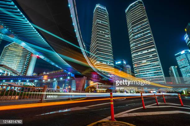 lujiazui financial district, pudong, shanghai, city road and high-rise building at night. - road junction stock pictures, royalty-free photos & images
