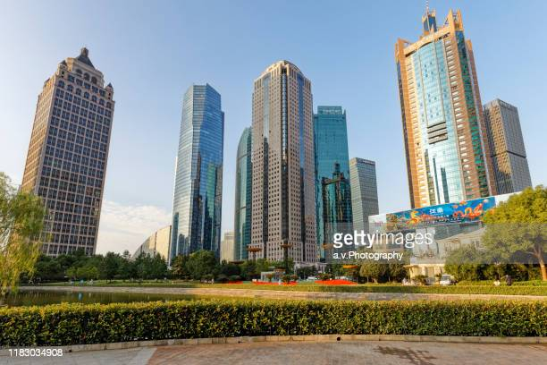 lujiazui park in pudong with view on his offices in shanghai. - andre vogelaere stock pictures, royalty-free photos & images