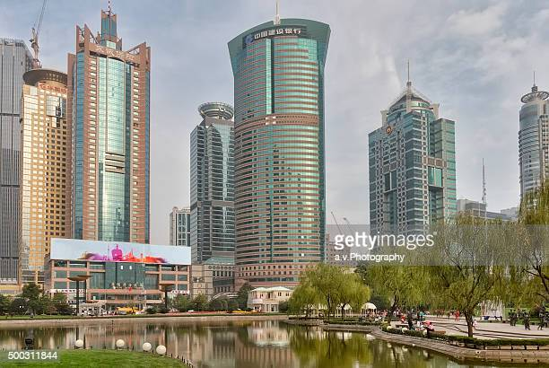 lujiazui park with view on high rise buildings - andre vogelaere stock pictures, royalty-free photos & images