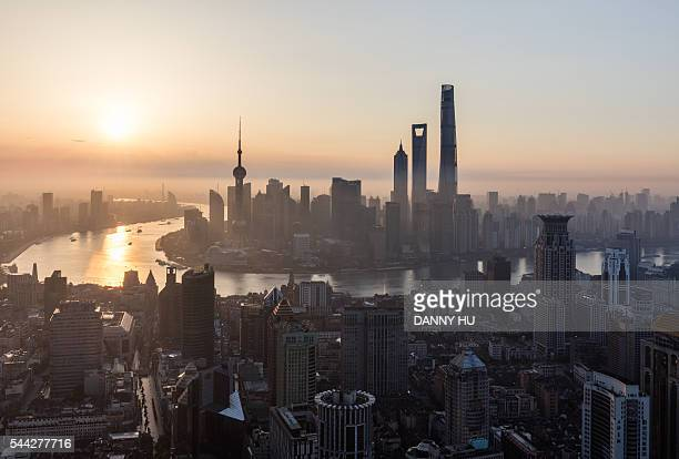 lujiazui skyline seen from puxi cbd at sunrise,shanghai,china - nanjing road stock pictures, royalty-free photos & images