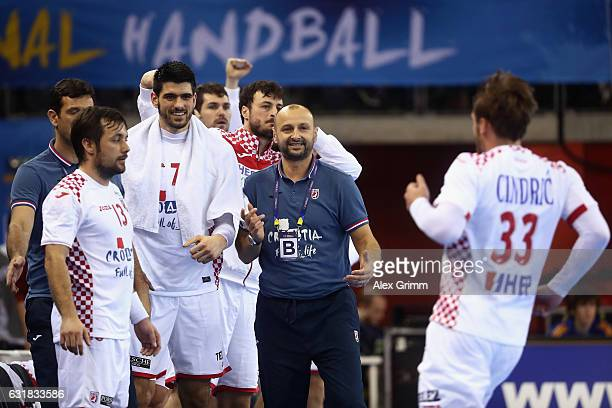 Luka Cindric of Croatia celebrates a goal with team mates and head coach Zeljko Babic during the 25th IHF Men's World Championship 2017 match between...