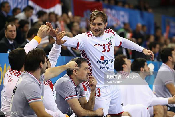 Luka Cindric of Croatia celebrates a goal with team mates during the 25th IHF Men's World Championship 2017 match between Croatia and Chile at...