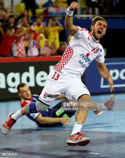 Luka Cindric of Croatia celebrates after scoring a goal during the Men's Handball European Championship main round match between Croatia and Norway...