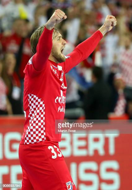 Luka Cindric of Croatia celebrates victory after the Men's Handball European Championship main round match between Croatia and Belarus at Arena...