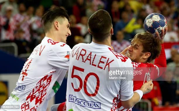Luka Cindric of Croatia challenges Artsem Karalek of Belarus during the Men's Handball European Championship main round match between Croatia and...
