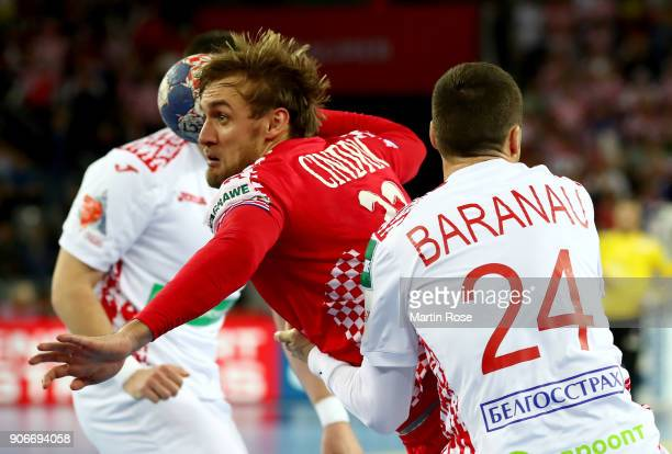Luka Cindric of Croatia challenges Maksim Baranau of Belarus during the Men's Handball European Championship main round match between Croatia and...