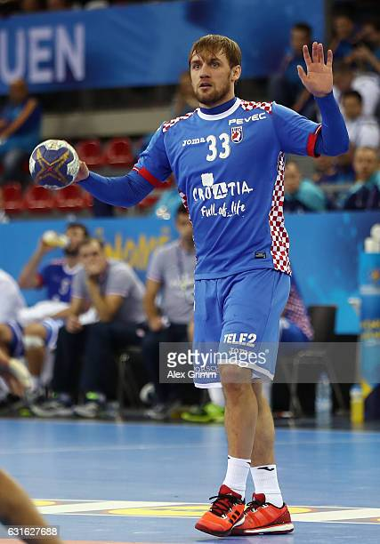 Luka Cindric of Croatia controles the ball during the 25th IHF Men's World Championship 2017 match between Croatia and Saudi Arabia at Kindarena on...