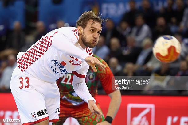 Luka Cindric of Croatia scores a goal from the penalty spot during the 25th IHF Men's World Championship 2017 match between Croatia and Belarus at...