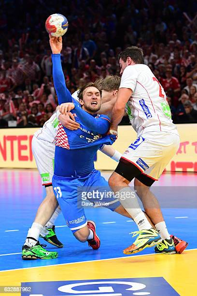 Luka Cindric of Croatia tries to break through the Norway defence during the World Championship Semi Final match between Norway and Croatia on...