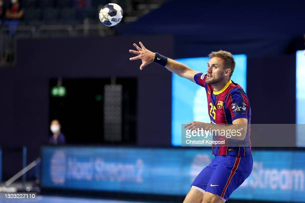 Luka Cindric of FC Barcelona passes the ball during the VELUX EHF Champions League FINAL4 semi-final between FC Barcelona v HBC Nantes at Lanxess...