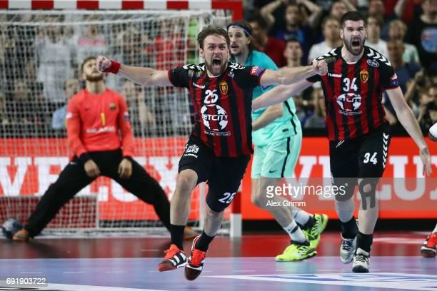 Luka Cindric of Vardar celebrates scoring the winning goal during the VELUX EHF FINAL4 Semi Final between HC Vardar and FC Barcelona Lassa at Lanxess...