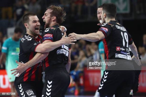 Luka Cindric of Vardar celebrates with team mates after scoring the winning goal during the VELUX EHF FINAL4 Semi Final between HC Vardar and FC...