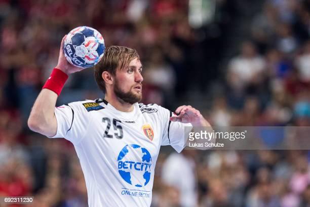 Luka Cindric of Vardar holds the ball during the VELUX EHF FINAL4 Final match between Paris SaintGermain Handball and HC Vardar at Lanxess Arena on...