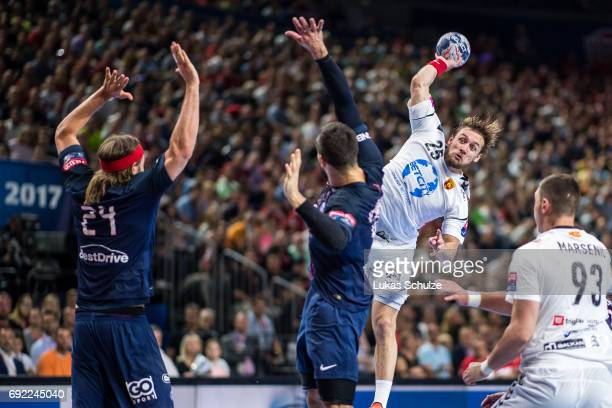 Luka Cindric of Vardar is attacked by the defense of Paris during the VELUX EHF FINAL4 Final match between Paris SaintGermain Handball and HC Vardar...