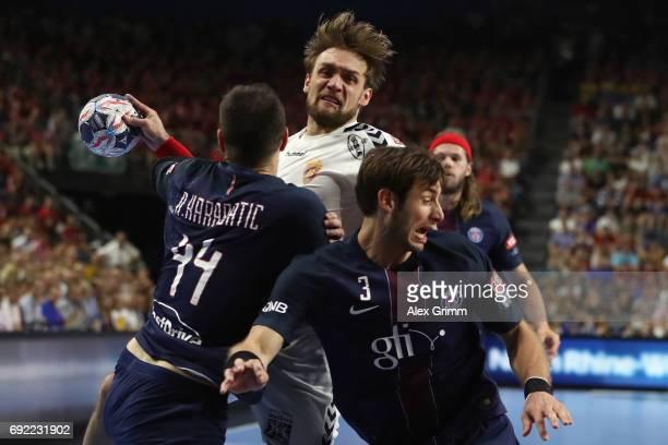 Luka Cindric of Vardar is challenged by Nikola Karabatic and Uwe Gensheimer of Paris during the VELUX EHF FINAL4 final between Paris SaintGermain...