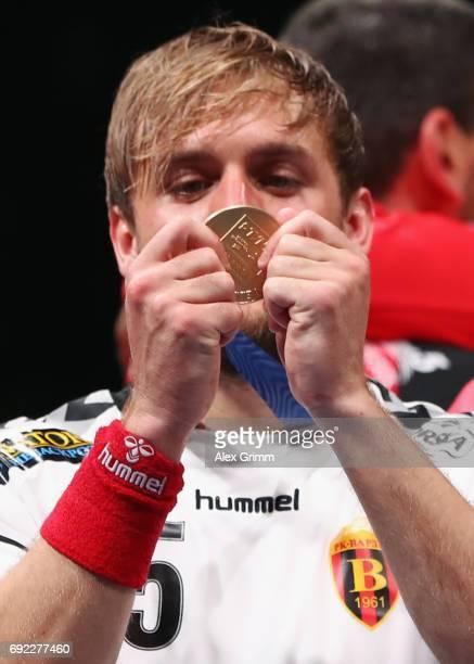 Luka Cindric of Vardar looks at his gold medal after his team won the VELUX EHF FINAL4 final between Paris SaintGermain Handball and HC Vardar at...