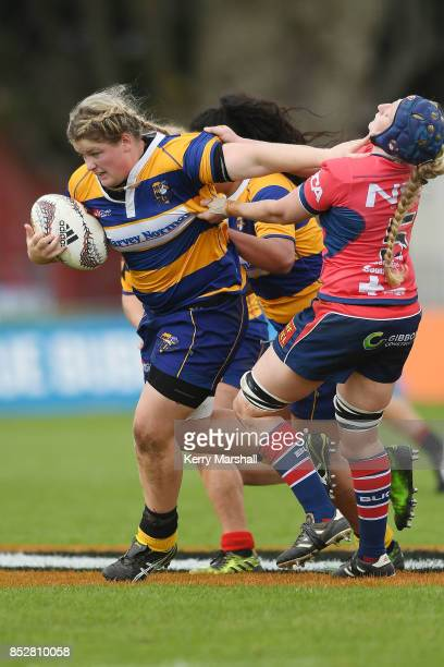 Luka Connor of Bay of Plenty fends Hannah Gillespie of Tasman during the round four Farah Palmer Cup match between Bay of Plenty and Tasman at...