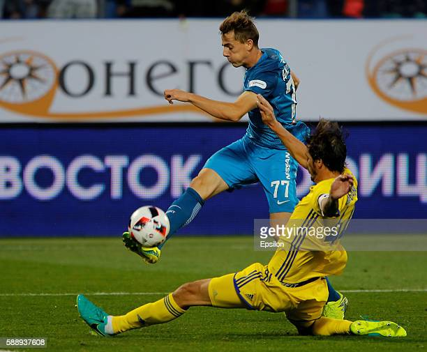 Luka Djordjevic of FC Zenit St Petersburg shoots the ball as Cesar Navas of FC Rostov RostovonDon defends during the Russian Football League match...