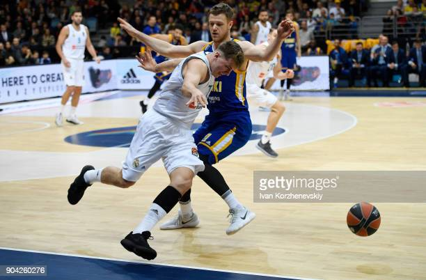 Luka Doncic #7 of Real Madrid competes with Andrey Zubkov #20 of Khimki Moscow Region during the 2017/2018 Turkish Airlines EuroLeague Regular Season...