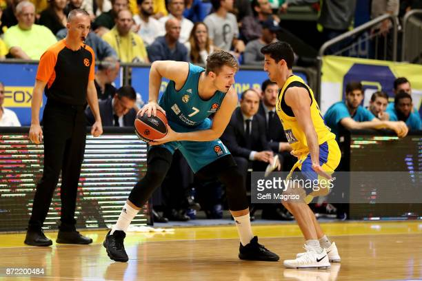 Luka Doncic #7 of Real Madrid competes with John Dibartolomeo #12 of Maccabi Fox Tel in action during the 2017/2018 Turkish Airlines EuroLeague...