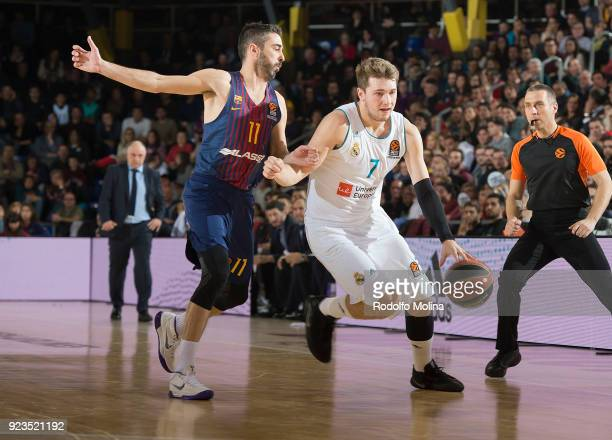 Luka Doncic #7 of Real Madrid competes with Juan Carlos Navarro #11 of FC Barcelona Lassa during the 2017/2018 Turkish Airlines EuroLeague Regular...