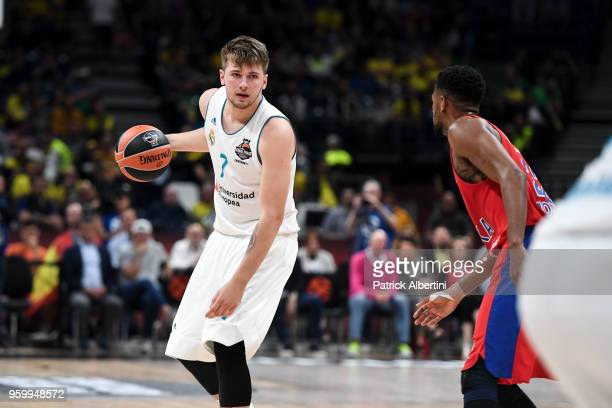Luka Doncic #7 of Real Madrid competes with Kyle Hines #42 of CSKA Moscow during the 2018 Turkish Airlines EuroLeague F4 Semifnal B game between...