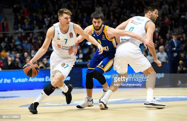 Luka Doncic #7 of Real Madrid competes with Stefan Markovic #9 of Khimki Moscow Region during the 2017/2018 Turkish Airlines EuroLeague Regular...