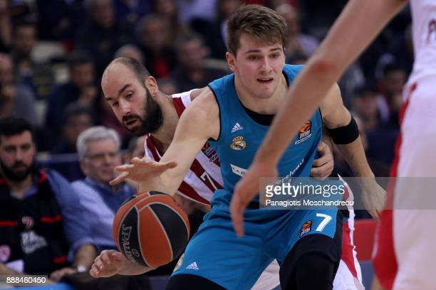 Luka Doncic #7 of Real Madrid competes with Vassilis Spanoulis #7 of Olympiacos Piraeus during the 2017/2018 Turkish Airlines EuroLeague Regular...