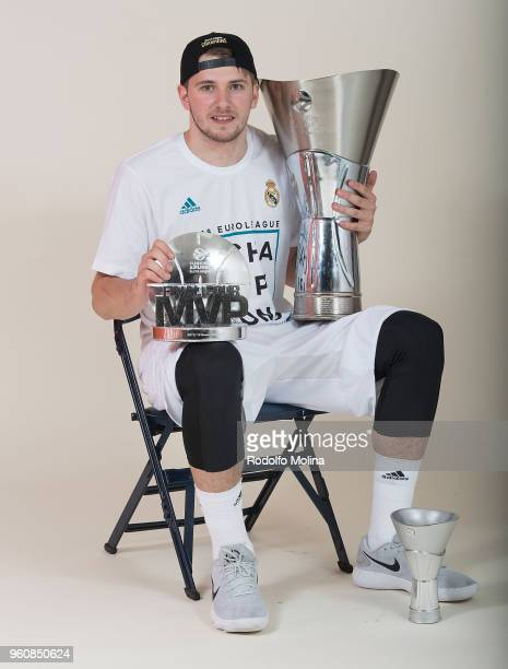 Luka Doncic #7 of Real Madrid poses with Chamipons Trophy and MVP of the final Trophy during the2018 Turkish Airlines EuroLeague F4 Champion Photo...