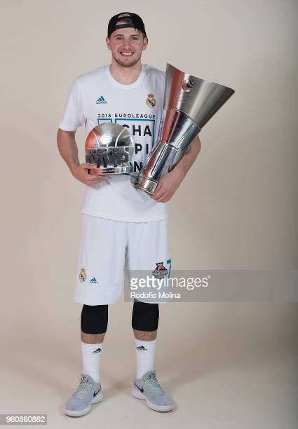 Luka Doncic #7 of Real Madrid poses with Chamipons Trophy and MVP of the final Trophy 2018 Turkish Airlines EuroLeague F4 Champion Photo Session with...