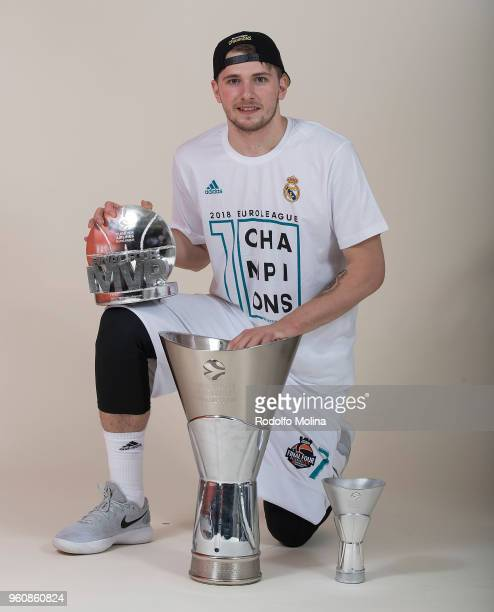 Luka Doncic #7 of Real Madrid poses with Chamipons Trophy replica and MVP of the final Trophy 2018 Turkish Airlines EuroLeague F4 Champion Photo...