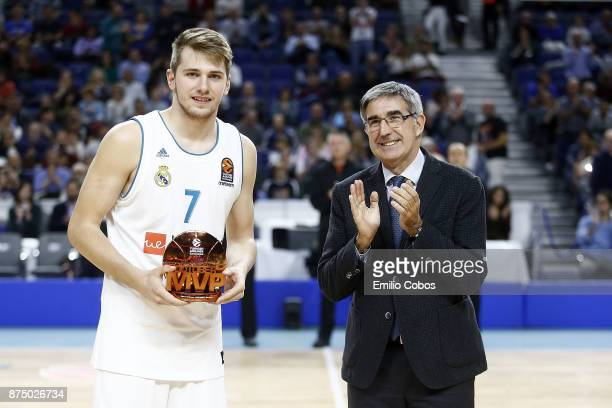 Luka Doncic #7 of Real Madrid receives the October Euroleague MVP trophy from Jordi Bertomeu President and CEO of Euroleague Basketball before the...