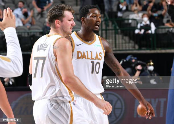 Luka Doncic and Dorian Finney-Smith of the Dallas Mavericks look on during the game against the Brooklyn Nets on May 6, 2021 at the American Airlines...