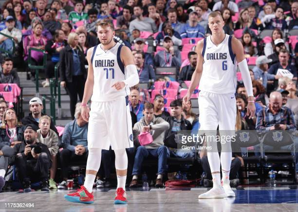 Luka Doncic and Kristaps Porzingis of the Dallas Mavericks looks on against the Milwaukee Bucks during a preseason game on October 11 2019 at the...