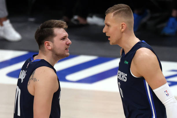 Luka Doncic and Kristaps Porzingis of the Dallas Mavericks react against the LA Clippers in the first quarter in game three of the Western Conference...