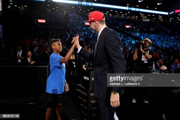 Luka Doncic exchanges a high five after being selected number third overall by the Atlanta Hawks on June 21 2018 at Barclays Center during the 2018...