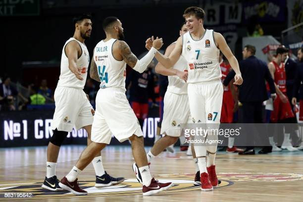 Luka Doncic Jeffery Taylor and Gustavo Ayon of Real Madrid celebrate their victory after the Turkish Airlines Euroleague basketball match between...