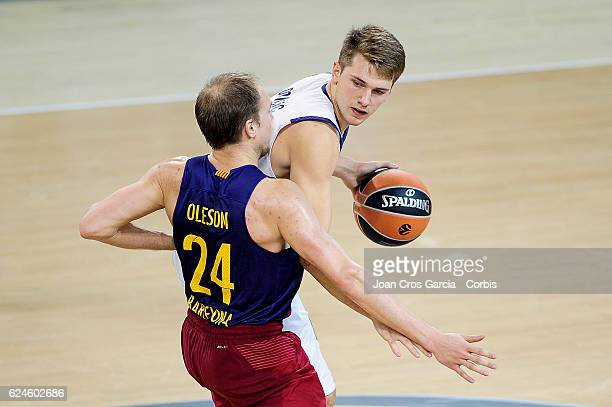 Luka Doncic of Real Madrid fighting for the ball with Brad Oleson of FC Barcelona Lassa during the basketball Turkish Airlines Euroleague match...