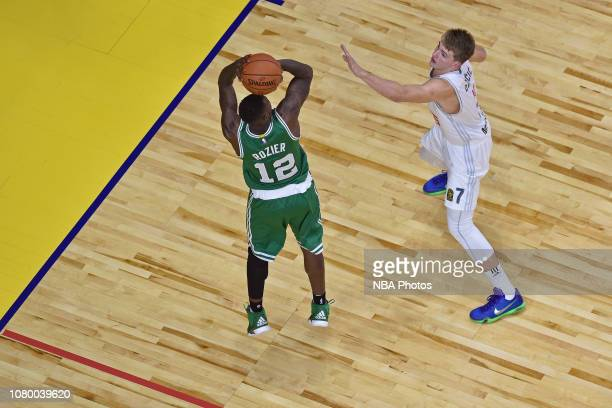Luka Doncic of Real Madrid guards Terry Rozier of the Boston Celtics as part of the 2015 Global Games on October 8 2015 at the Barclaycard Center in...