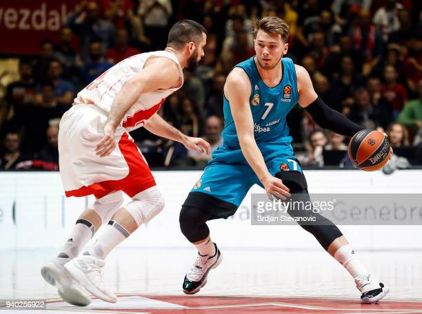 Luka Doncic of Real Madrid in action against Branko Lazic of Crvena Zvezda during the 2017/2018 Turkish Airlines EuroLeague Regular Season game...