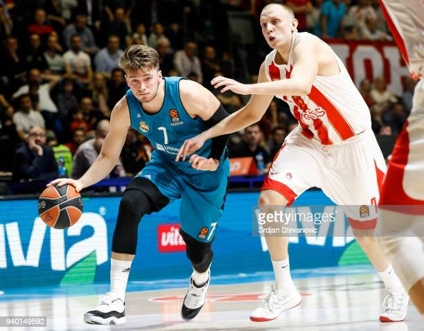 Luka Doncic of Real Madrid in action against Dejan Davidovac of Crvena Zvezda during the 2017/2018 Turkish Airlines EuroLeague Regular Season game...