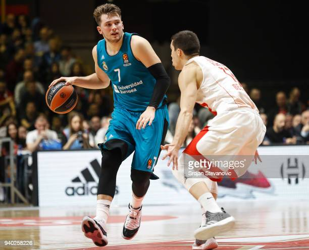 Luka Doncic of Real Madrid in action against Ognjen Dobric of Crvena Zvezda during the 2017/2018 Turkish Airlines EuroLeague Regular Season game...