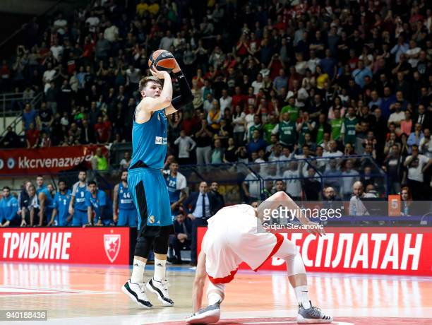 Luka Doncic of Real Madrid scores winning point over Ognjen Dobric of Crvena Zvezda during the 2017/2018 Turkish Airlines EuroLeague Regular Season...