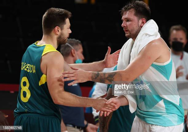 Luka Doncic of Team Slovenia and Matthew Dellavedova of Team Australia shakes hands after the Men's Basketball Bronze medal game on day fifteen of...