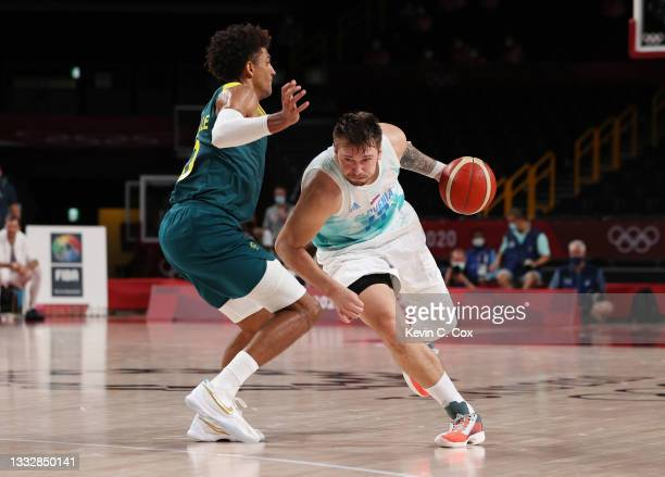 Luka Doncic of Team Slovenia drives to the basket against Matisse Thybulle of Team Australia during the second half of the Men's Basketball Bronze...